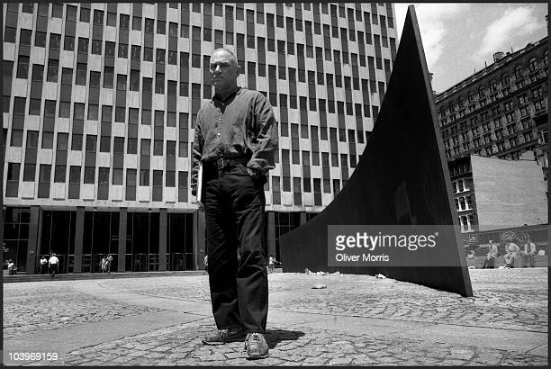 Portrait of American artist and sculptor Richard Serra as he poses with his massive steel sculpture 'Tilted Arc' in Federal Plaza New York New York...