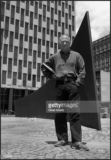 Portrait of American artist and sculptor Richard Serra as he poses with his massive steel sculpture 'Tilted Arc' in Federal Plaza, New York, New...