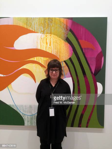 Portrait of American artist Carrie Moyer as she poses in front of one of her paintings 'Candy Cap' during the Whitney Biennial New York New York...