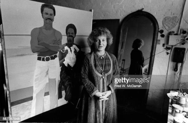 Portrait of American artist Marcia Marcus in her studio in front of one of her paintings New York City New York October 251970