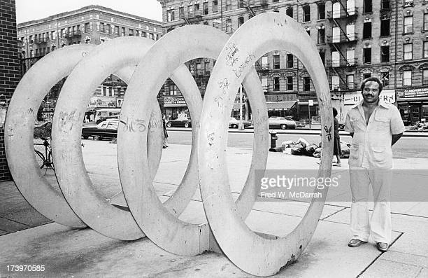 Portrait of American artist Melvin Edwards as he poses with his sculpture 'Harlem Double Circles' New York New York August 30 1978