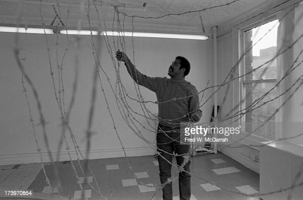 Portrait of American artist Melvin Edwards constructs a sculture with barbed wire in an empty studio space New York New York February 20 1970