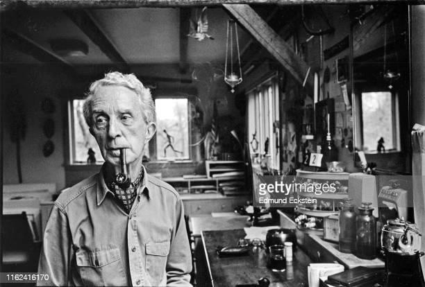 Portrait of American artist Norman Rockwell , a pipe in his mouth, as he poses in his studio, Stockbridge, Massachusetts, September 10, 1975.