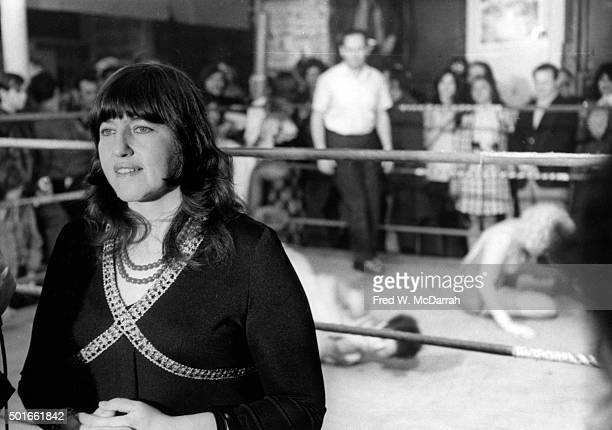 Portrait of American artist playwright and author Rosalyn Drexler as she attends a women's wrestling match New York New York March 8 1972