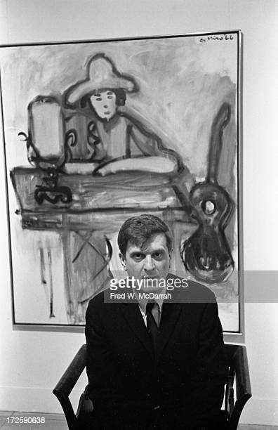 Portrait of American artist Robert De Niro Sr as he poses in front of one of his paintings at a gallery show New York New York January 14 1967