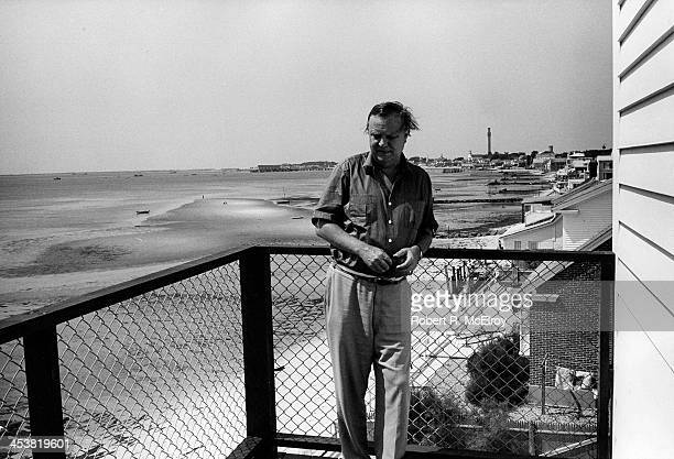 Portrait of American artist Robert Motherwell artist as he poses on the balcony of his home East Hamptons New York 1965