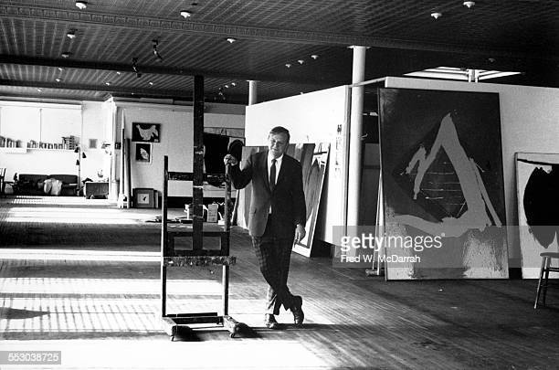 Portrait of American artist Robert Motherwell as he poses in his loft surrounded by some of his paintings New York New York February 181962