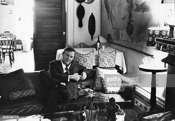 Portrait of American artist Robert Motherwell as he sits on a couch in his loft New York New York February 18 1962