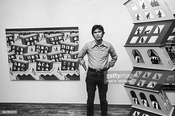 Portrait of American artist Roger Brown as he poses with his work at a show at the Phyllis Kind Gallery New York New York September 22 1977