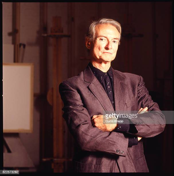 Portrait of American artist Roy Lichtenstein as he poses in at his West Village studio New York New York September 23 1991
