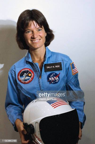 Portrait of American astronaut Sally Ride as she poses with a helmet in her hands at the Johnson Space Center Houston Texas 1983 At the time she was...