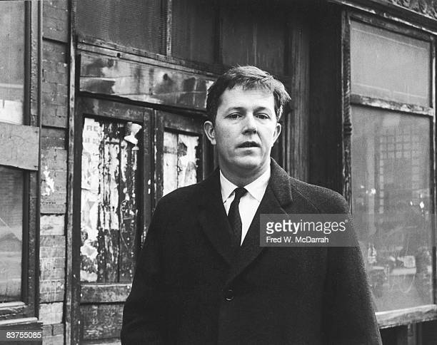 Portrait of American author activist and educator Michael Harrington as he stands on Thompson Street New York New York January 29 1964 His 1962 book...