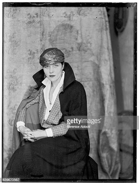 Portrait of American author and artist Djuna Barnes as she poses seated on a chair 1920s
