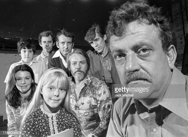 Portrait of American author and playwright Kurt Vonnegut Jr as he poses with the cast during rehearsals for his OffBroadway play 'Happy Birthday...