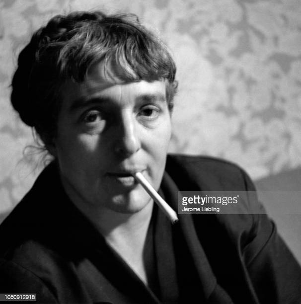 Portrait of American author and political activist Meridel Le Sueur as she smokes a cigarette Minneapolis Minnesota 1950