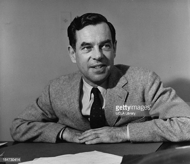 Portrait of American author educator and mythologist Joseph Campbell as he sits behind a desk at Sarah Lawrence College Yonkers New York 1953