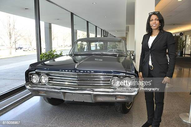 Portrait of American author Ilyasah Shabazz daughter of Malcolm X and Betty Shabazz as she poses beside her father's car on display at Malcolm X...