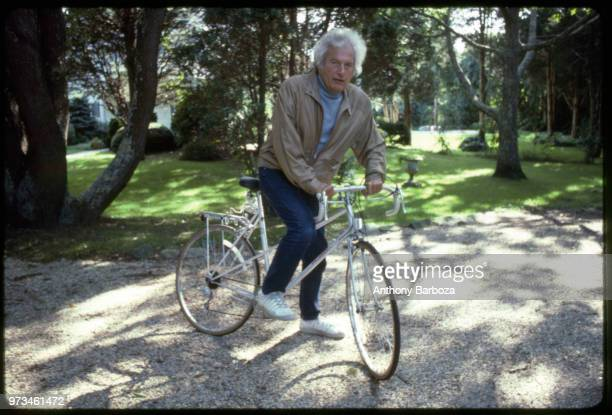 Portrait of American author Joseph Heller on a bicycle Long Island NY 1998