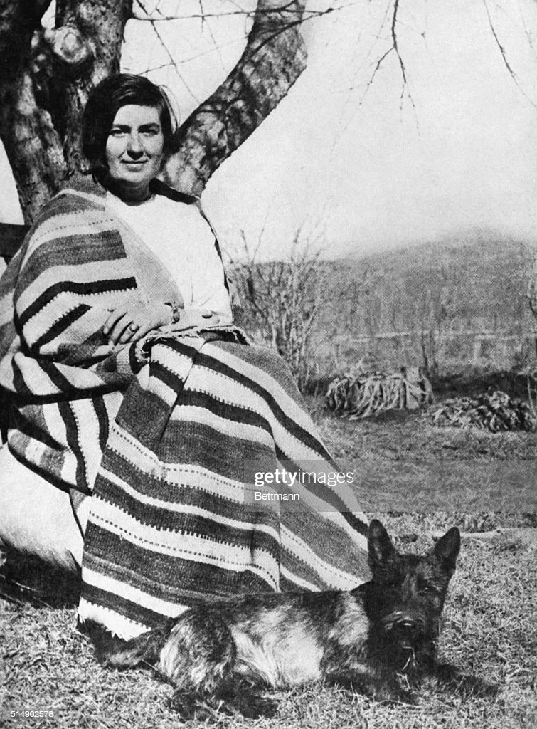 Mabel Dodge Luhan Seated Outside W/Dog Pictures | Getty Images