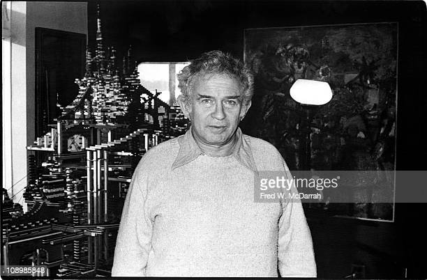 Portrait of American author Norman Mailer as he poses in front of a massive city built from Legobrand building blocks in his home New York New York...
