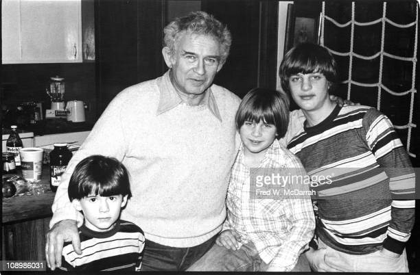 Portrait of American author Norman Mailer as he poses with his sons Matthew Stephen and Michael in their home New York New York January 5 1978