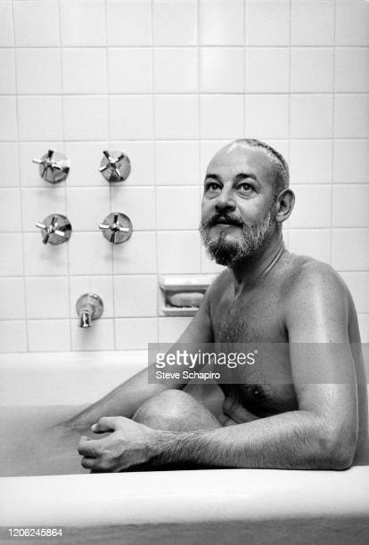Portrait of American author Patrick Dennis as he sits in a bathtub New York New York 1963
