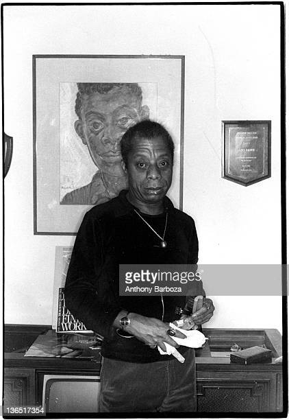 Portrait of American author playright and activist James Baldwin as he poses in his home New York New York late 1970s