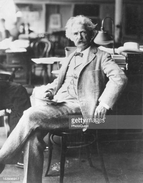 Portrait of American author Samuel Clemens better known as Mark Twain as he sits in a chair late 19th century