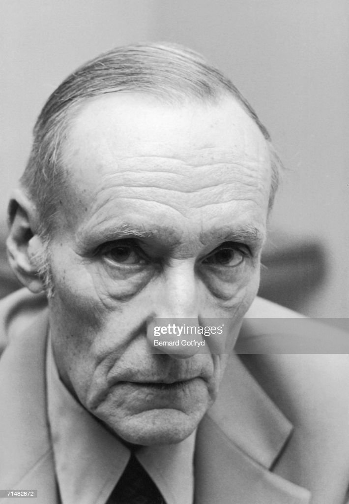 Portrait of American author William S. Burroughs (1914 - 1997) as he sits and wears a pale suit, New York, 1981. Burroughs is best known for his baroquely surreal semi-autobiographical accounts of his years of drug addiction. Towards the end of his life he had careers as a spoken word performer and running shoe pitchman.