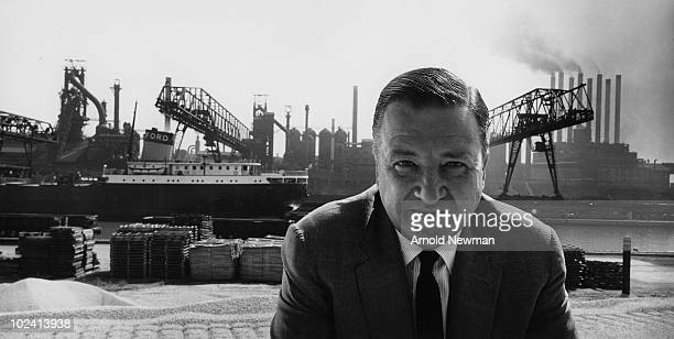 Portrait of American automobile manufacturer Henry Ford II as he poses in front of a cargo dock Detroit Michigan June 27 1960