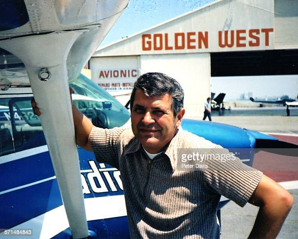 Portrait of American aviator and former CIA pilot Francis Gary Powers as he poses beside a plane 1972