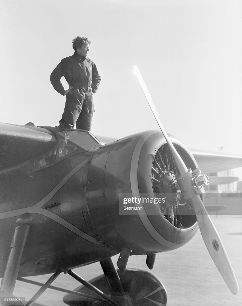 Portrait of American aviatrix Amelia Earhart (1898-1937), the first woman to cross the Atlantic Ocean in an airplane. She is shown here standing atop her plane. Undated photograph.