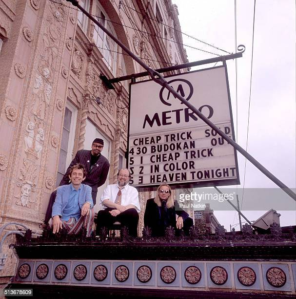 Portrait of American band Cheap Trick posed atop the marquee of the Metro auditorium Chicago Illinois May 1 1998 Pictured are from left Robin Zander...