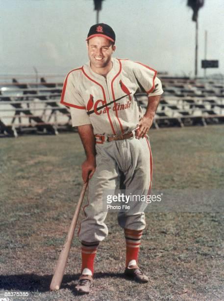 Portrait of American baseball player Joe Garagiola of the St Louis Cardinals as he leans on a baseball bat late 1940s