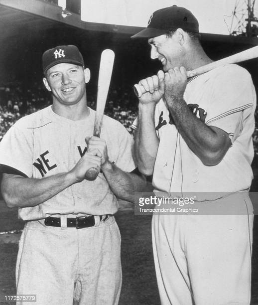 Portrait of American baseball player Mickey Mantle of the New York Yankees and Ted Williams of the Boston Red Sox pose together before a game Boston...