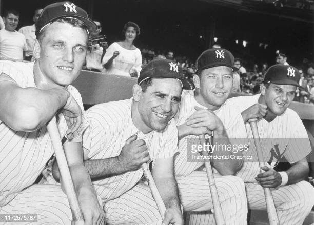 Portrait of American baseball players from left Roger Maris Yogi Berra Mickey Mantle and Bill Skowron all of the New York Yankees as they pose in...