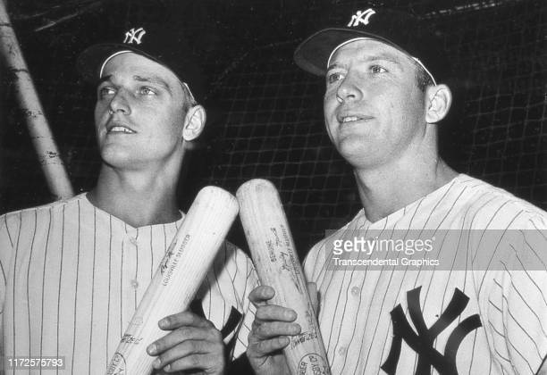 Portrait of American baseball players Roger Maris and Mickey Mantle both of the New York Yankees as they pose together before a game at Yankee...