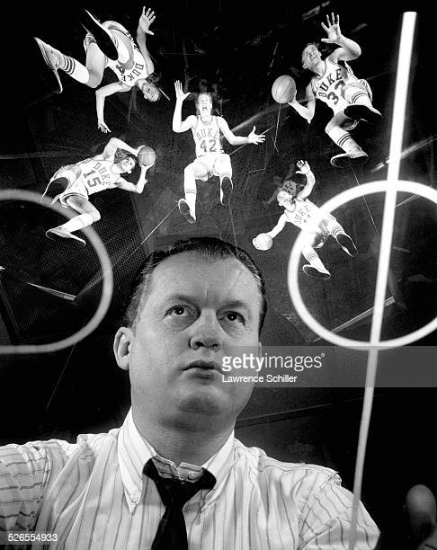 Portrait of American basketball coach Vic Bubas of Duke University Durham North Carolina 1966 Over him are his players Mike Lewis Steve Vacendak Jack...