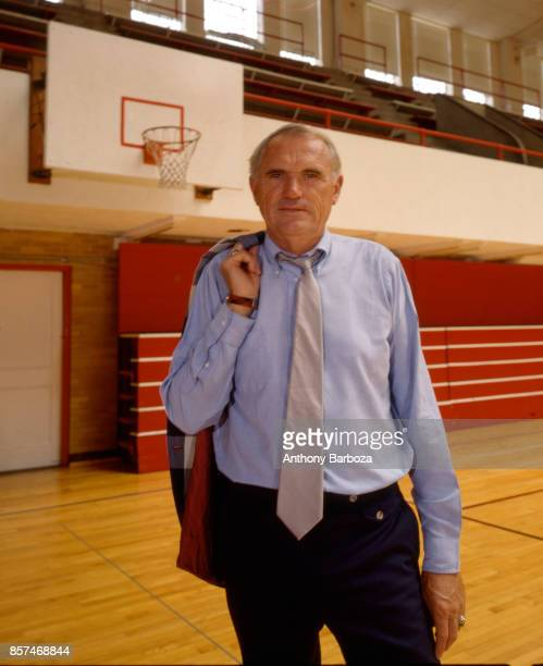 Portrait of American basketball coach Winfrey 'Wimp' Sanderson of the University of Alabama as he stand on the court in the university's Foster...
