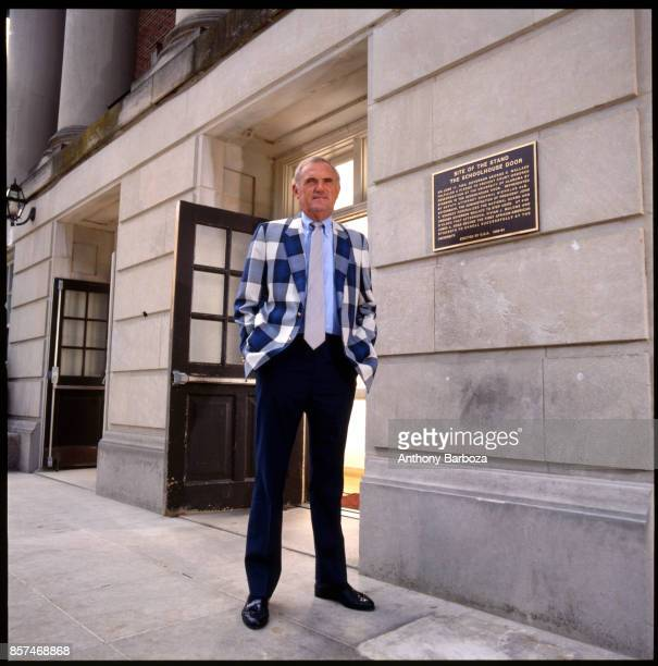 Portrait of American basketball coach Winfrey 'Wimp' Sanderson of the University of Alabama as he poses outside the university's Foster Auditorium...