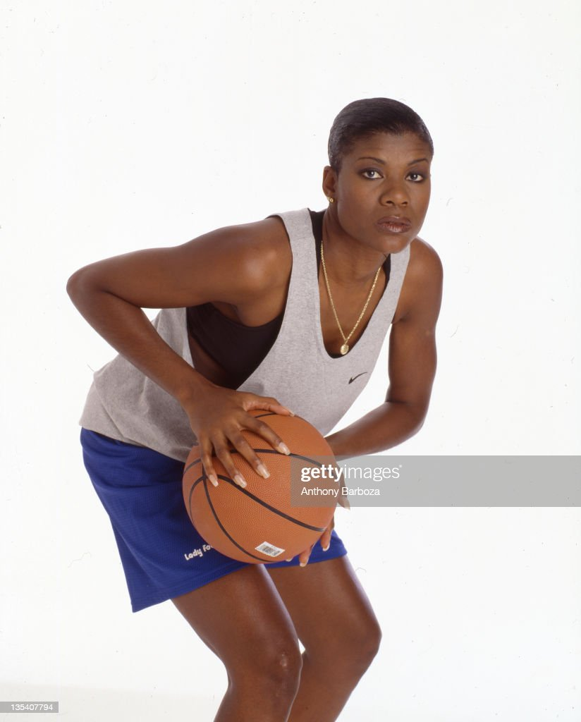 Portrait of American basketball player Sheryl Swoopes as she poses against a white background, a basketball in her hands, New York, New York, 1990s.