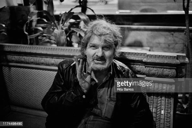 Portrait of American Beat poet Gregory Corso as he sits on a bench in the Chelsea Hotel, New York, New York, March 22, 1991.
