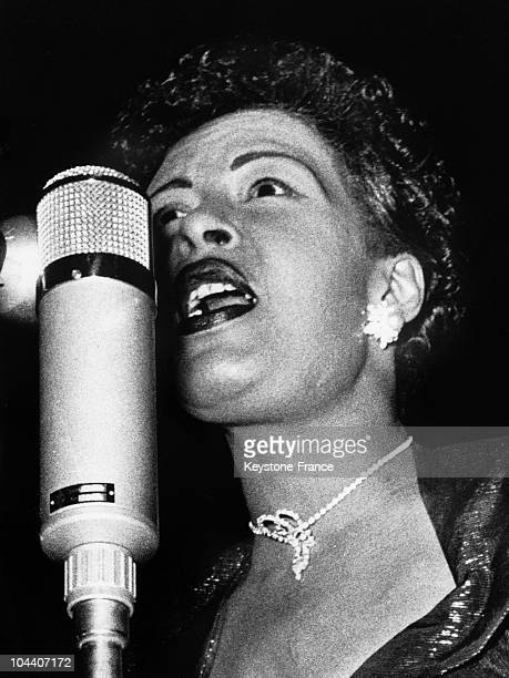 Portrait of American blues and jazz singer Billie HOLIDAY singing in Hamburg
