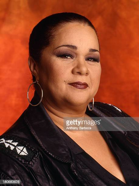 Portrait of American blues and jazz singer Etta James as she poses against an orange background Los Angeles California 1995