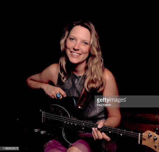 Portrait of American Blues musician Susan Tedeschi as she poses with her guitar backstage at the Rosemont Theater Rosemont Illinois September 3 2000