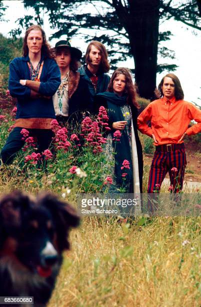 Portrait of American Blues Rock group Big Brother and the Holding Company as they pose in a park in the Haight Ashbury neighborhood San Francisco...
