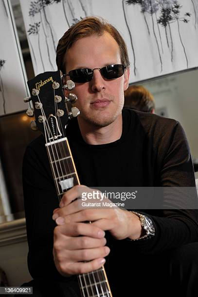 Portrait of American bluesrock musician Joe Bonamassa posing with his signature Les Paul Goldtop Outfit guitar taken on January 27 2009 in London