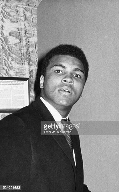 Portrait of American boxer Muhammad Ali as he checks into a hotel New York New York February 28 1968