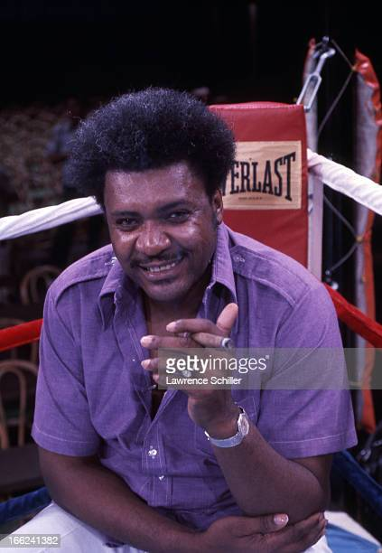 Portrait of American boxing promoter Don King as he smokes a cigar in the ring the day before 'the Thrilla in Manila' at the Araneta Coliseum Quezon...