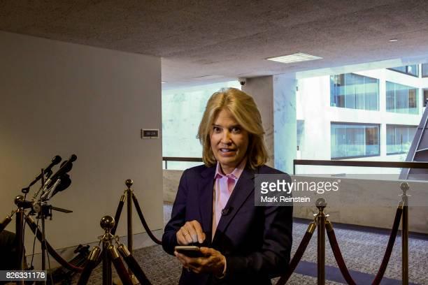 Portrait of American broadcast journalist Greta Van Susteren holds her smartphone outside room 216 of the Hart Senate Office Building Washington DC...